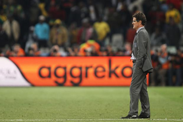 Fabio Capello manager of England looks on dejected after losing to Germany during the 2010 FIFA World Cup South Africa Round of Sixteen match between Germany and England at Free State Stadium on June 27, 2010 in Bloemfontein, South Africa