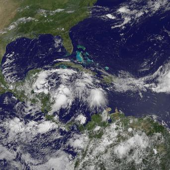 A satellite photo shows a large area of cloud that formed into Tropical Storm Alex