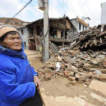 In Yunnan province, floodwaters receded enough for some people to inspect their homes