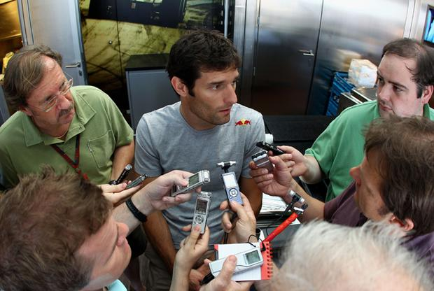 Mark Webber of Australia and Red Bull Racing is interviewed by the media following his dramatic accident during the European Formula One Grand Prix at the Valencia Street Circuit on July 27, 2010, in Valencia, Spain