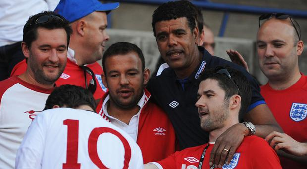 TV pundit Chris Kamara with fans ahead of the 2010 FIFA World Cup South Africa Round of Sixteen match between Germany and England at Free State Stadium on June 27, 2010 in Bloemfontein, South Africa