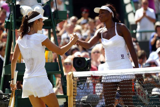 Tsvetana Pironkova of Bulgaria (L) celebrates winning her Quarter Final match against Venus Williams of USA (R) on Day Eight of the Wimbledon Lawn Tennis Championships