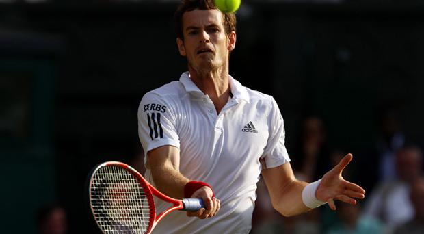 Andy Murray of Great Britain in action during his Quarter Final match against Jo-Wilfred Tsonga of France on Day Nine of the Wimbledon Lawn Tennis Championships