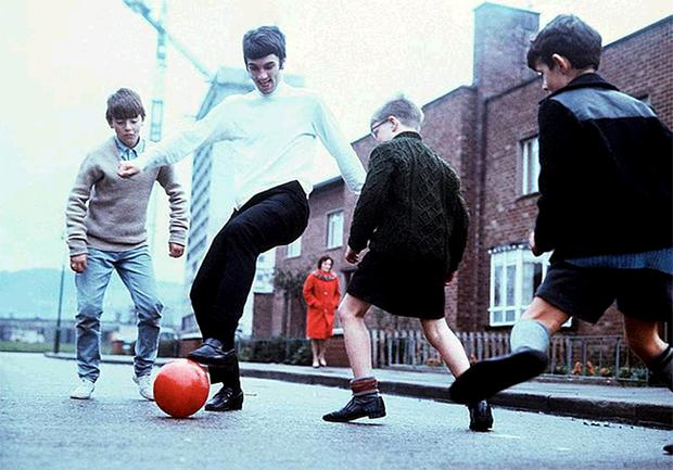 George Best at the peak of his powers shows kids how it should be done in a Cregagh estate street in 1969... if you were one of those boys, phone us on 02890 264427