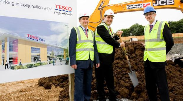 Tesco has started construction work on a Tesco Extra store at Marlborough Retail Park in Craigavon, Co Armagh. Craigavon mayor Stephen Moutray cut the first sod at the Marlborough Retail Park site joined by Trevor Turkington, chief executive of contractor Turkington Holdings (centre) and Bernard Owens, senior store development manager for Tesco Northern Ireland
