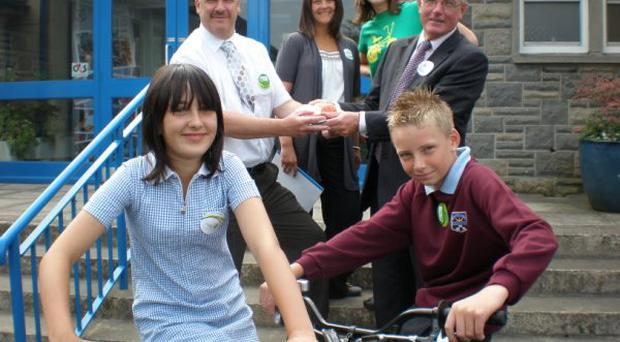 Stanton Sloan Chief Executive SEELB, Mrs Smart, teacher and Sustrans Bike It officer, Jill Smyth and David McCartney, principal, join the children for the launch of the travel plan