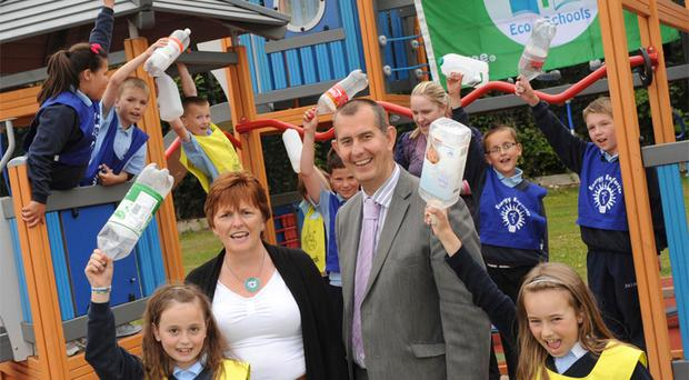 Minister Edwin Poots with members of the school's 'Swat Team'