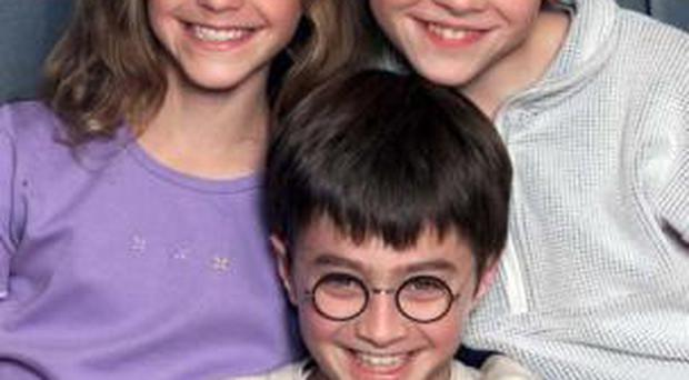 Fresh faced actors Emma Watson, Daniel Radcliffe and Rupert Grint, who play Hermione Granger, Harry Potter and Ron Weasley, at their first ever press conference in 2000.
