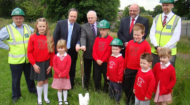 Pictured with pupils at the sod cutting for the new Whitehouse Primary School are, from left, Victor Hamilton, Project Manager, GRAHAM Construction, Nigel Dodds MP, David McConkey, School Principal, Shane McCurdy, Chief Executive, NEELB and Keith Patrick, projects director, GRAHAM Construction