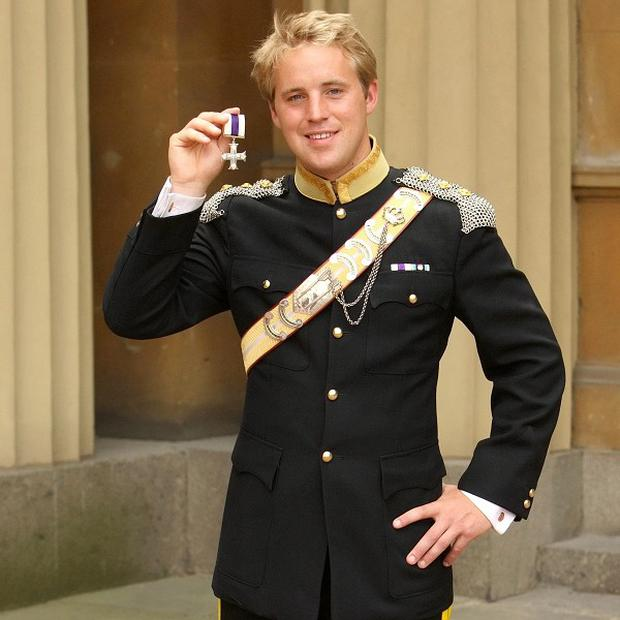 Captain Rowley Gregg, from the Light Dragoons, holds the Military Cross awarded to him by the Princess Royal at an investiture ceremony at Buckingham Palace