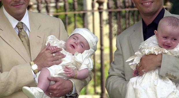 Gay couple Barrie and Tony Drewitt-Barlow at the baptism of their first two children, surrogate twins Aspen and Saffron in 2000