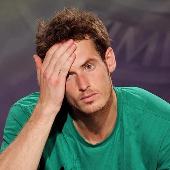 Andy Murray's Wimbledon dreams were shattered for another year after a straight-sets defeat by world number one Rafael Nadal in the semi-finals