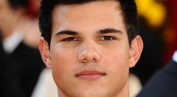 Taylor Lautner says he wasn't nervous about kissing Kristen Stewart