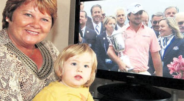 Marion McDowell, mum of US Open golf champion Graeme, with Graeme's nephew Zac, another up-and-coming golfer