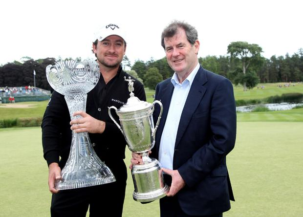 JP McManus (right) holds the US Open trophy after presenting Graeme McDowell of Northern Ireland (left) with a special trophy to mark his US Open victory after the first round of The JP McManus Invitational Pro-Am event at the Adare Manor Hotel and Golf Resort on July 5, 2010 in Limerick