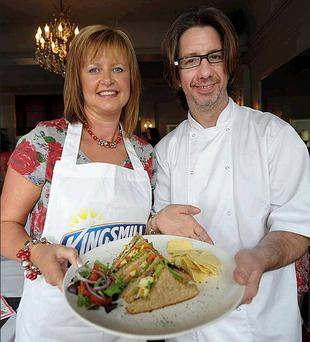 County Down finalist at Kingsmill's Masterpiece Grand Final, Ashley Knox presents the overall winning recipe of smoked cheese, pesto, roasted peppers and onions with sundried tomatoes and rocket sandwich to host and judge, Michelin star chef Michael Deane