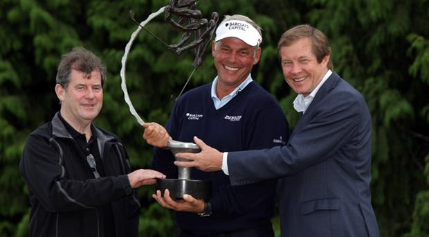 Darren Clarke of Northern Ireland is presented with the the trophy by JP McManus (left) and George O'Grady of The European Tour (right) after winning The JP McManus Invitational Pro-Am event at the Adare Manor Hotel and Golf Resort on July 6, 2010 in Limerick