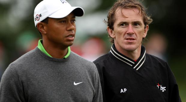 Tiger Woods of the USA walks with jockey Tony McCoy during the second round of The JP McManus Invitational Pro-Am event at the Adare Manor Hotel and Golf Resort on July 6, 2010 in Limerick
