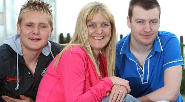 Happy family: Deborah and her sons Adam and Peter. Inset, the boys as toddlers