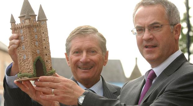 John Harrison/Harrison Photography Social Development Minister Alex Attwood with Mayor of Newtownards Councillor David Smyth holding a model of Scrabo tower when he announced the Town Centre Master plan.Photo John Harrison.