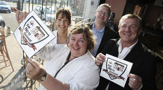Kathy Wolff, Community Relations Forum, joins Claire Fox from Newtownabbey Council, Ian Patterson of E.A. Davies Insurance and Frank McNeill, Thunderdome Café to launch Glengormley's new logo