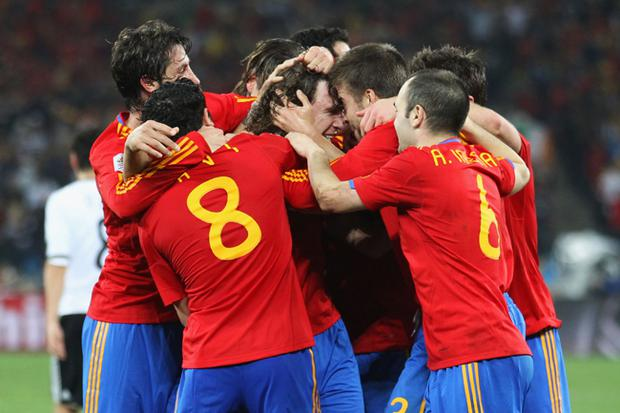 Spain team mates celebrate the opening goal by Carles Puyol during the 2010 FIFA World Cup South Africa Semi Final match between Germany and Spain at Durban Stadium