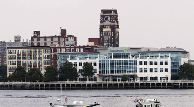 Rescue vessels above the Delaware River after a tourist boat was struck by a barge (AP)
