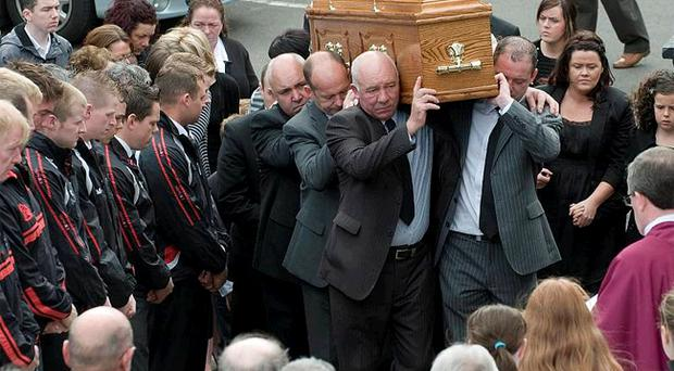 Members of St Aidan's GAA Club form a guard of honour for father-of-one Gary Butcher