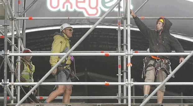 Workers preparing a stage at the Oxegen festival, which hasn't sold out