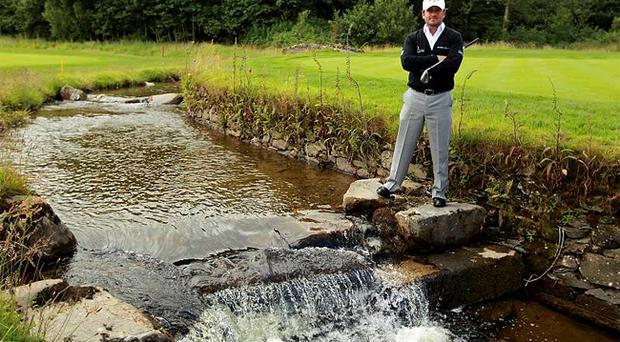 Graeme McDowell will hope to steer clear of water hazards like this at Loch Lomond