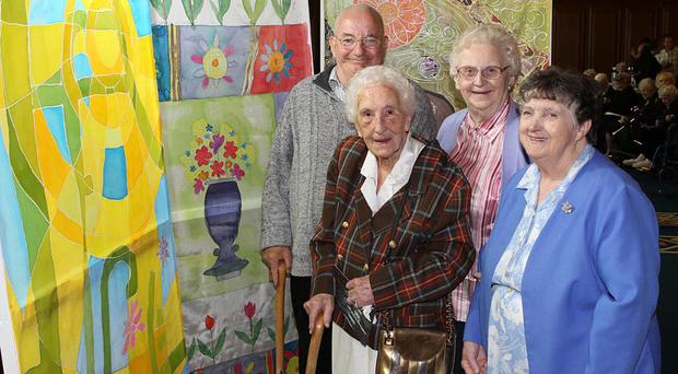Admiring the artwork produced during Arts Care's Creative Age Festival are programme participants (l-r) Tom Rennie, Edith Taylor, Mona Philips and May Halliday from Chestnut Grove, north Belfast