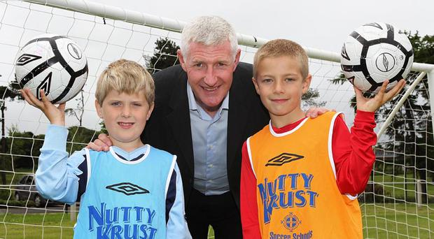 Budding young footballers from the Irish FA Nutty Krust Summer Soccer School at Mossley Pavilion with Northern Ireland manager Nigel Worthington