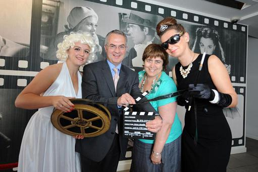 Social Development Minister Alex Attwood and Clanmil chief executive Clare McCarty are joined by cinematic icons, Audrey Hepburn and Marilyn Monroe (Clanmil staff Claire Gowan and Nuala McGonigal) to mark the official opening of the new Clanmil 42 apartment development, on the site of the former Curzon cinema
