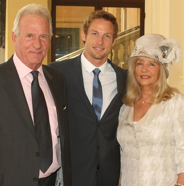 Formula One driver Jenson Button with his parents John and Simone. His mother had to be evacuated from a hotel fire.