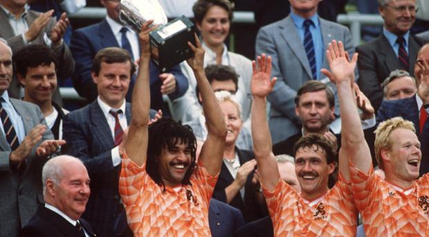 Ruud Gullit, pictured winning the European Championship in 1988, has been on call for Holland coach Bert van Marwijk
