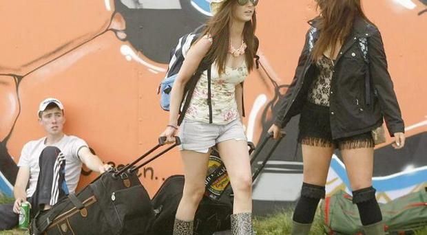 Festival goers begin to arrive for the Oxegen Music festival at Punchestown race course in Co Kildare.