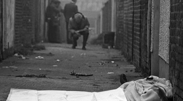 <b>Images from the Belfast Telegraph Troubles Gallery</b> The body of catholic man lies in an entry off the Shankill Road in West Belfast after being murdered by members of the Shankill butchers. 25/10/82. Pacemaker Press