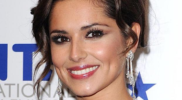 Cheryl Cole left intensive care and has been transferred to a private clinic