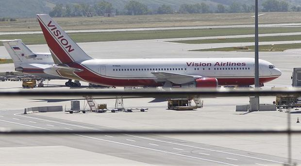 US and Russian planes parked at Vienna airport where a 14-person spy swap is thought to have taken place (AP)