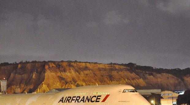 An Air France passenger jet sits on the tarmac after making an emergency landing due to a bomb threat in Brazil (AP)