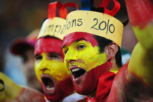 Spain fans enjoy the atmosphere during the 2010 FIFA World Cup South Africa Final match between Netherlands and Spain at Soccer City Stadium on July 11, 2010 in Johannesburg, South Africa