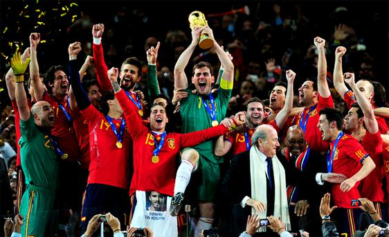 Iker Casillas, captain of Spain (C), celebrate with his team mates after they won the World Cup in a 1-0 victory over Holland at Soccer City Stadium on July 11, 2010 in Johannesburg