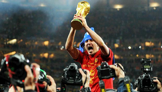 David Villa holds the World Cup trophy after Spain's 1-0 win over Holland in Johannesburg