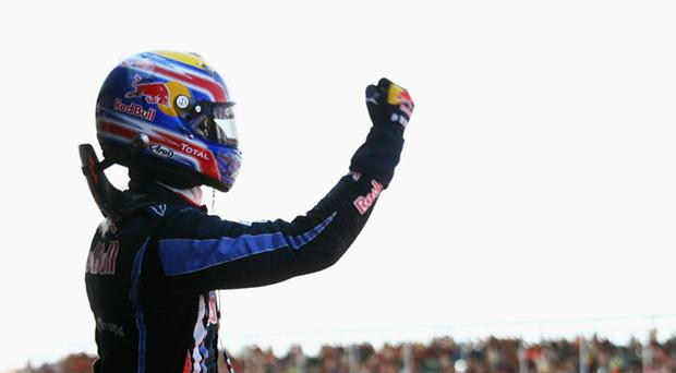 Mark Webber of Australia and Red Bull Racing celebrates in parc ferme after winning the British Formula One Grand Prix at Silverstone on June 11, 2010