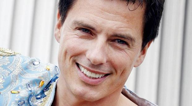 Actor John Barrowman claims one of his Desperate Housewives co-stars offered to have a baby for him
