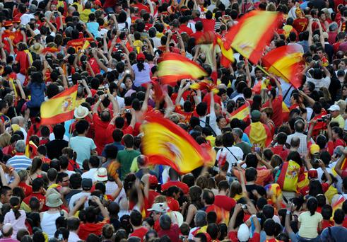 Spain fans pack the streets of Madrid to welcome the national football team home after they won the World Cup in South Africa