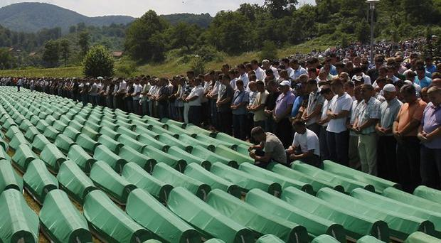 Prayers are said near coffins of Srebrenica victims during a mass funeral (AP)
