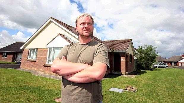 Peter McMullan outside the house of the senior citizen who he |discovered in her hallway""