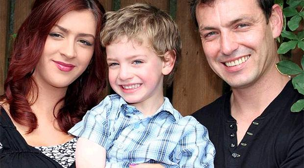 Four-year-old Taylor with his mum Lauramay and his father Marty