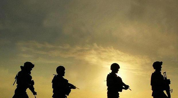 A manhunt is under way after three British soldiers were killed by a renegade Afghan soldier